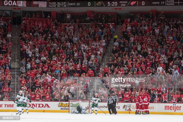 Anthony Mantha of the Detroit Red Wings scores the first NHL goal at the new Little Caesars Arena and celebrates with teammates Mike Green Martin Frk...