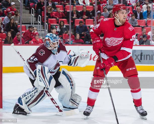 Anthony Mantha of the Detroit Red Wings sets up in front of Jonathan Bernier of the Colorado Avalanche during an NHL game at Little Caesars Arena on...