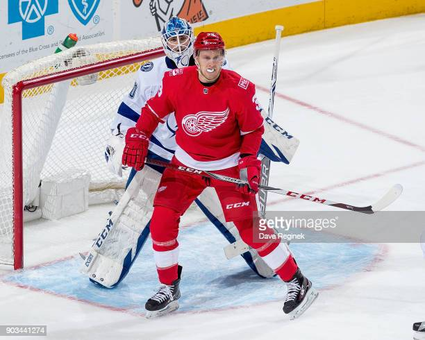 Anthony Mantha of the Detroit Red Wings sets up in front of Louis Domingue of the Tampa Bay Lightning during an NHL game at Little Caesars Arena on...