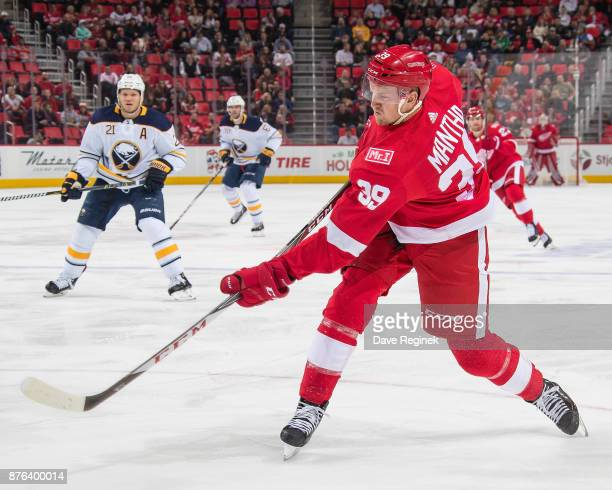 Anthony Mantha of the Detroit Red Wings shoots the puck against the Buffalo Sabres during an NHL game at Little Caesars Arena on November 17 2017 in...