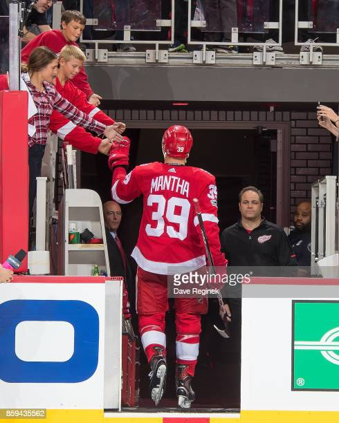 Anthony Mantha of the Detroit Red Wings ''skates off the ice after the first ever NHL game at the new Little Caesars Arena against the Minnesota Wild...