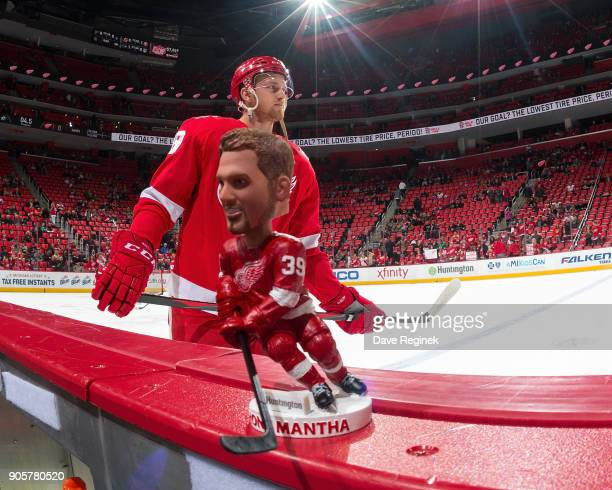 Anthony Mantha of the Detroit Red Wings skates past a bobblehead of himself during warmups prior to an NHL game against the Dallas Stars at Little...
