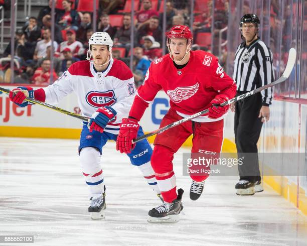 Anthony Mantha of the Detroit Red Wings skates up ice in front of Andrew Shaw of the Montreal Canadiens during an NHL game at Little Caesars Arena on...
