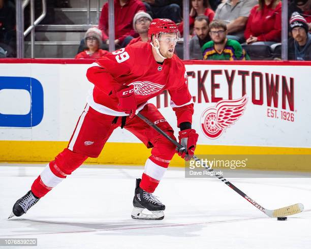 Anthony Mantha of the Detroit Red Wings skates up ice with the puck against the Colorado Avalanche during an NHL game at Little Caesars Arena on...