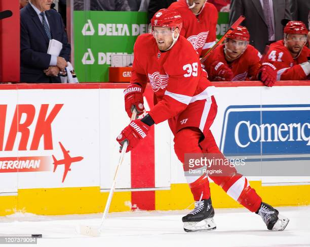 Anthony Mantha of the Detroit Red Wings skates up ice with the puck against the Montreal Canadiens during an NHL game at Little Caesars Arena on...