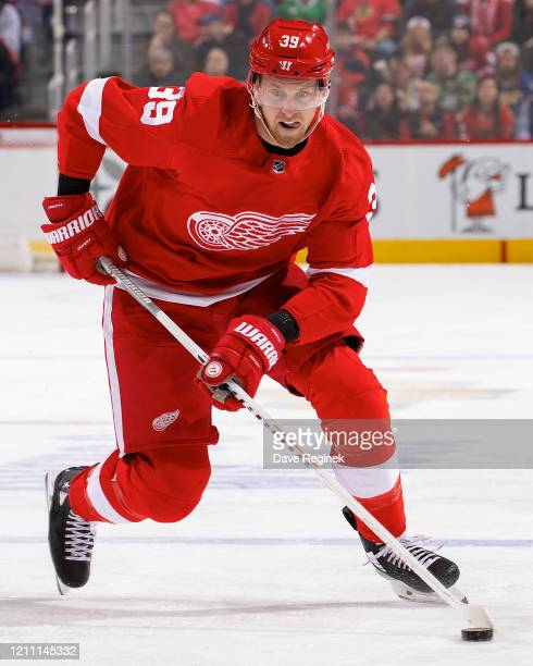 Anthony Mantha of the Detroit Red Wings skates up ice with the puck against the Chicago Blackhawks during an NHL game at Little Caesars Arena on...