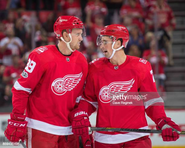 Anthony Mantha of the Detroit Red Wings talks with teammate Dylan Larkin after scoring the first goal during the first ever NHL game at the new...