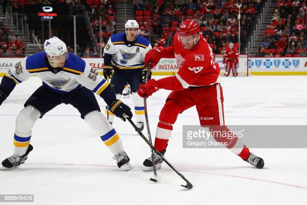 Anthony Mantha of the Detroit Red Wings tries to shoot around the stick of Colton Parayko of the St Louis Blues during the second period at Little...
