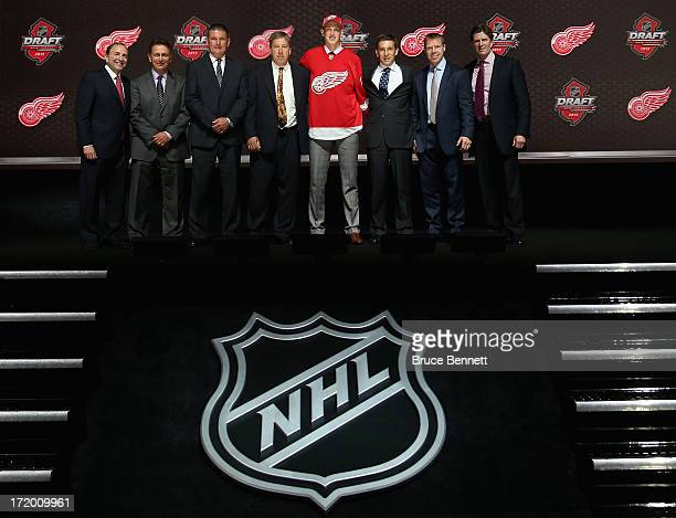 Anthony Mantha poses with the front office after being selected number twenty overall in the first round by the Detroit Red Wings during the 2013 NHL...