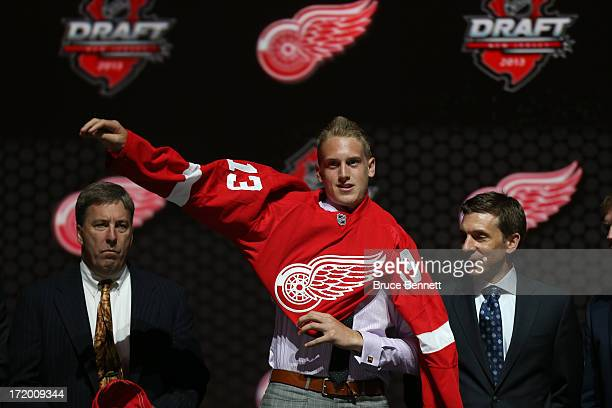 Anthony Mantha reacts puts on his jersey after being selected number twenty overall in the first round by the Detroit Red Wings during the 2013 NHL...