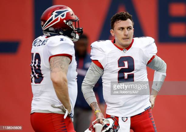 Anthony ManzoLewis and Johnny Manziel of the Memphis Express talk before taking on the Birmingham Iron during the first quarter of their Alliance of...