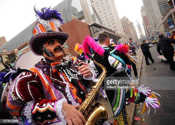 Anthony Marchese of Downingtown Pennsylvania and a member of the South Philadelphia String Band takes a break after performing during the 2011...
