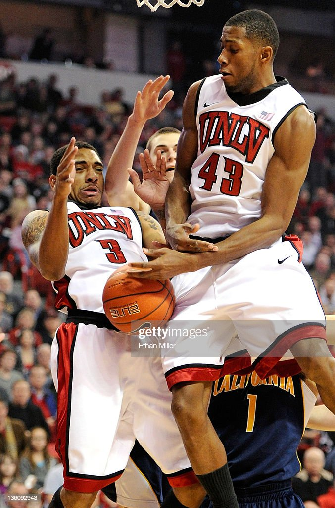 Anthony Marshall #3 and Mike Moser #43 of the UNLV Rebels go after a rebound against the California Golden Bears during their game at the Thomas & Mack Center December 23, 2011 in Las Vegas, Nevada. UNLV won 85-68.