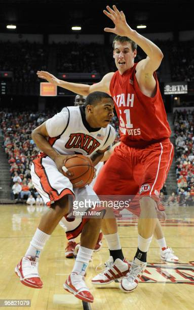 Anthony Marshall of the UNLV Rebels drives against David Foster of the Utah Utes during their game at the Thomas Mack Center January 16 2010 in Las...