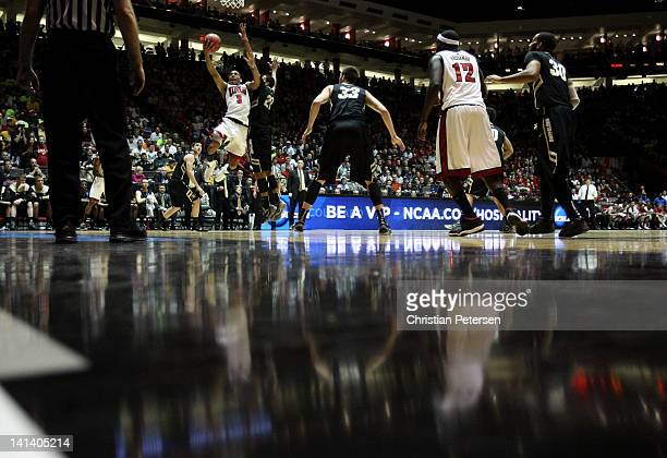 Anthony Marshall of the UNLV Rebels drives to the basket against Andre Roberson of the Colorado Buffaloes during the second round of the 2012 NCAA...