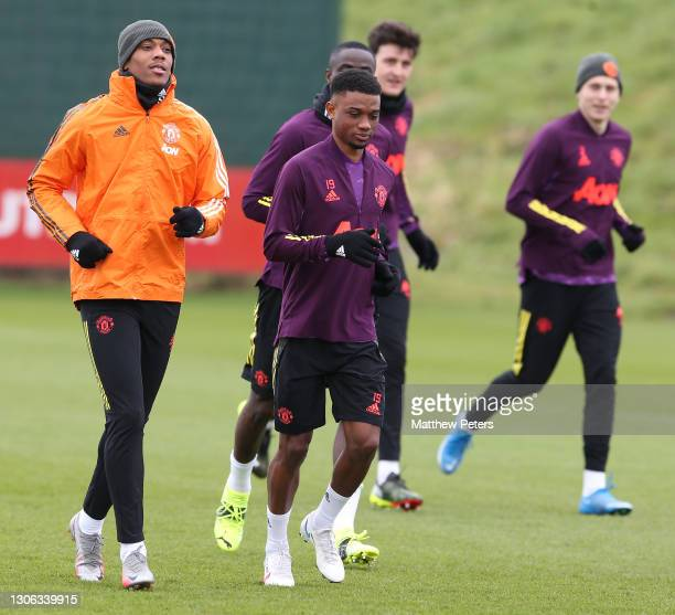 Anthony Martial and Amad of Manchester United in action during a first team training session at Aon Training Complex on March 10, 2021 in Manchester,...