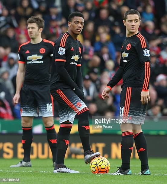 Anthony Martial and Ander Herrera of Manchester United show their disappointment at conceding a second goal during the Barclays Premier League match...