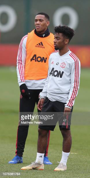 Anthony Martial and Angel Gomes of Manchester United in action during a first team training session at Aon Training Complex on December 28 2018 in...