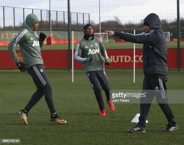 Anthony Martial and Ashley Young of Manchester United in action during a first team training session at Aon Training Complex on December 28 2017 in...