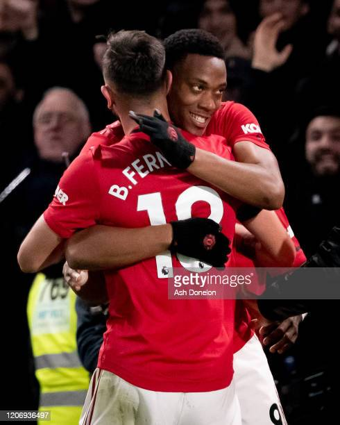 Anthony Martial and Bruno Fernandes of Manchester United celebrate Harry Maguire scoring their second goal during the Premier League match between...