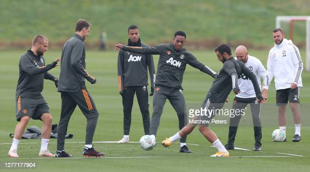 Anthony Martial and Bruno Fernandes of Manchester United in action during a first team training session at Aon Training Complex on September 28 2020...