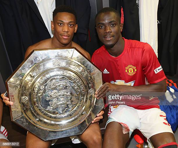 Anthony Martial and Eric Bailly of Manchester United pose with the Community Shield trophy in the dressing room after the FA Community Shield match...