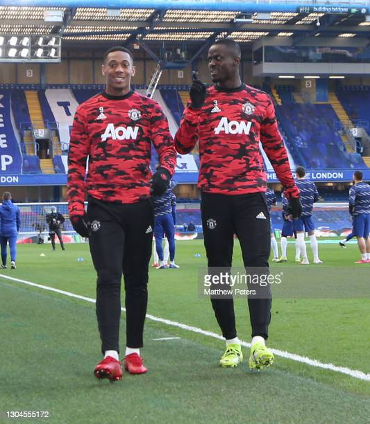 Anthony Martial and Eric Bailly of Manchester United warm up ahead of the Premier League match between Chelsea and Manchester United at Stamford...