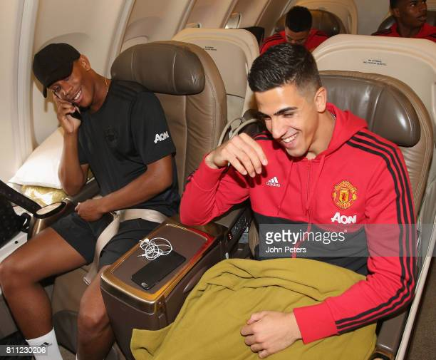 Anthony Martial and Joel Pereira of Manchester United sit on the aeroplane ahead of the club's preseason tour of the USA at Manchester Airport on...