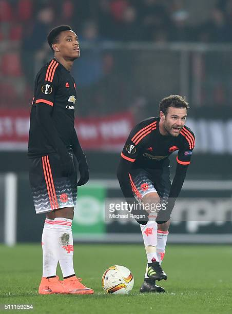 Anthony Martial and Juan Mata of Manchester United react after Midtjylland's second goal during the UEFA Europa League round of 32 first leg match...