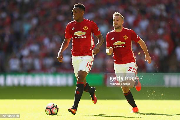 Anthony Martial and Luke Shaw of Manchester United during the Community Shield match between Leicester City and Manchester United at Wembley Stadium...