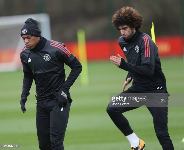 Anthony Martial and Marouane Fellaini of Manchester United in action during a first team training session at Aon Training Complex on March 12 2018 in...
