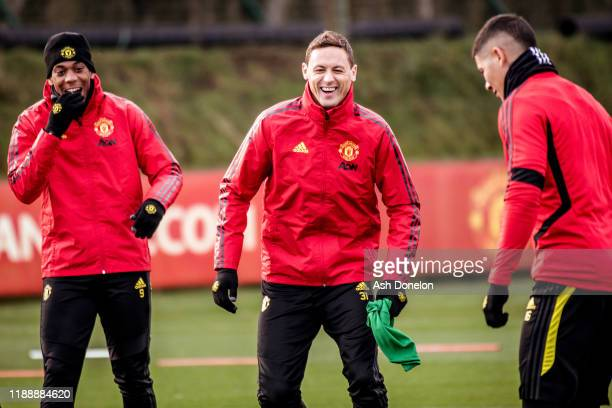 Anthony Martial and Nemanja Matic of Manchester United in action during a first team training session at Aon Training Complex on November 20 2019 in...