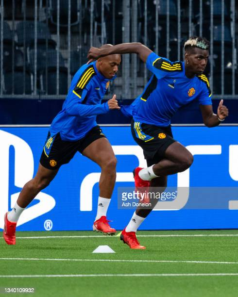 Anthony Martial and Paul Pogba of Manchester United in action during a first team training session at Stadion Wankdorf on September 13, 2021 in Bern,...
