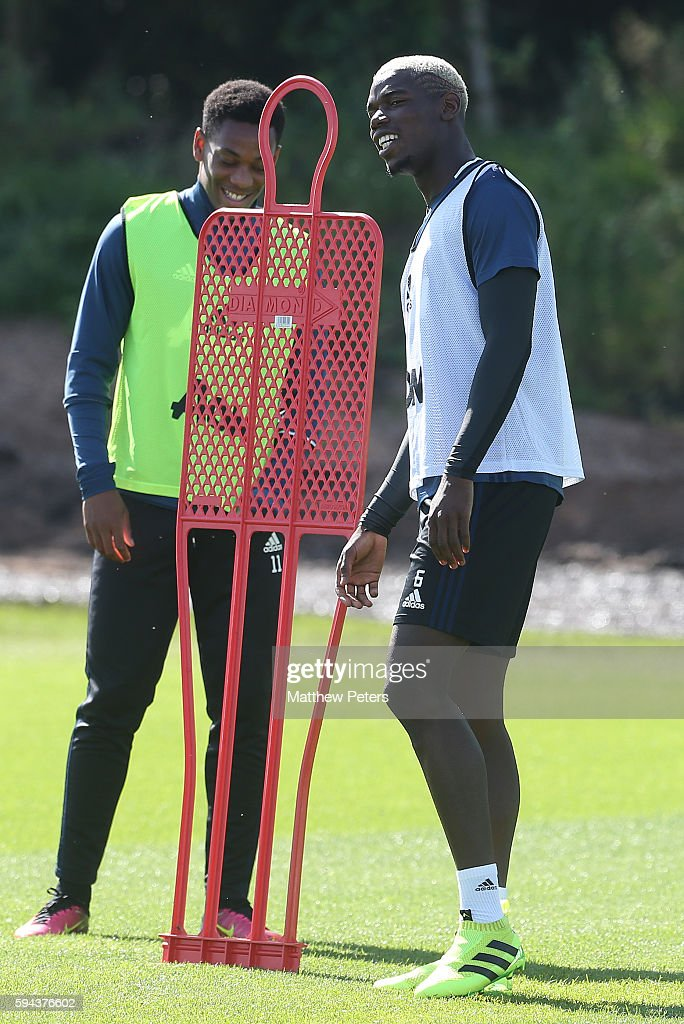 Anthony Martial and Paul Pogba of Manchester United in action during a first team training session at Aon Training Complex on August 23, 2016 in Manchester, England.