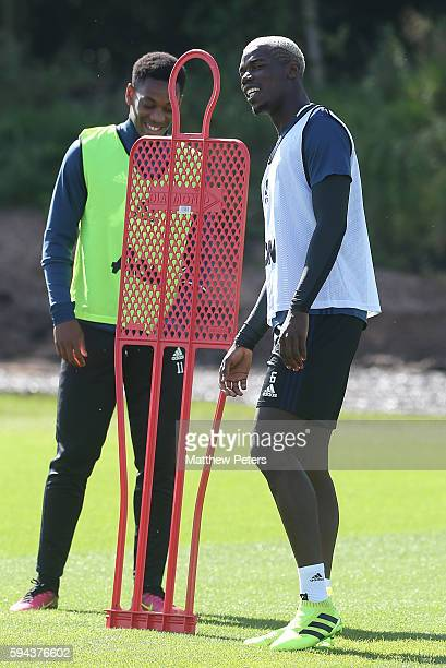 Anthony Martial and Paul Pogba of Manchester United in action during a first team training session at Aon Training Complex on August 23 2016 in...