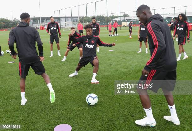 Anthony Martial Angel Gomes and Eric Bailly of Manchester United in action during a first team training session at Aon Training Complex on July 13...