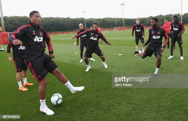 Anthony Martial Antonio Valencia and RoShaun Williams of Manchester United in action during a first team training session at Aon Training Complex on...