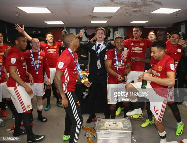 Anthony Martial Ashley Young Antonio Valencia and Jesse Lingard of Manchester United celebrate in the dressing room after the EFL Cup Final match...