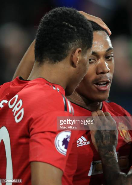 Anthony Martial celebrates with Marcus Rashford during the Premier League match between Cardiff City and Manchester United at Cardiff City Stadium on...