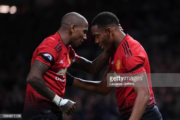Anthony Martial celebrates with teammate Ashley Young after scoring his teams second goal during the Premier League match between Manchester United...