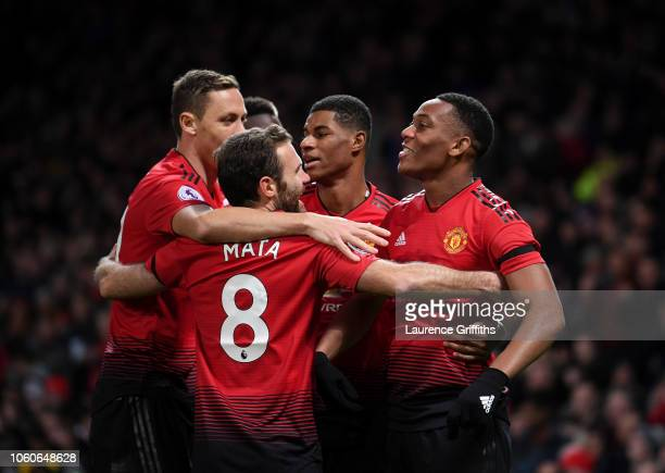 Anthony Martial celebrates with teammates Nemanja Matic Marcus Rashford and Juan Mata after scoring his team's second goal during the Premier League...