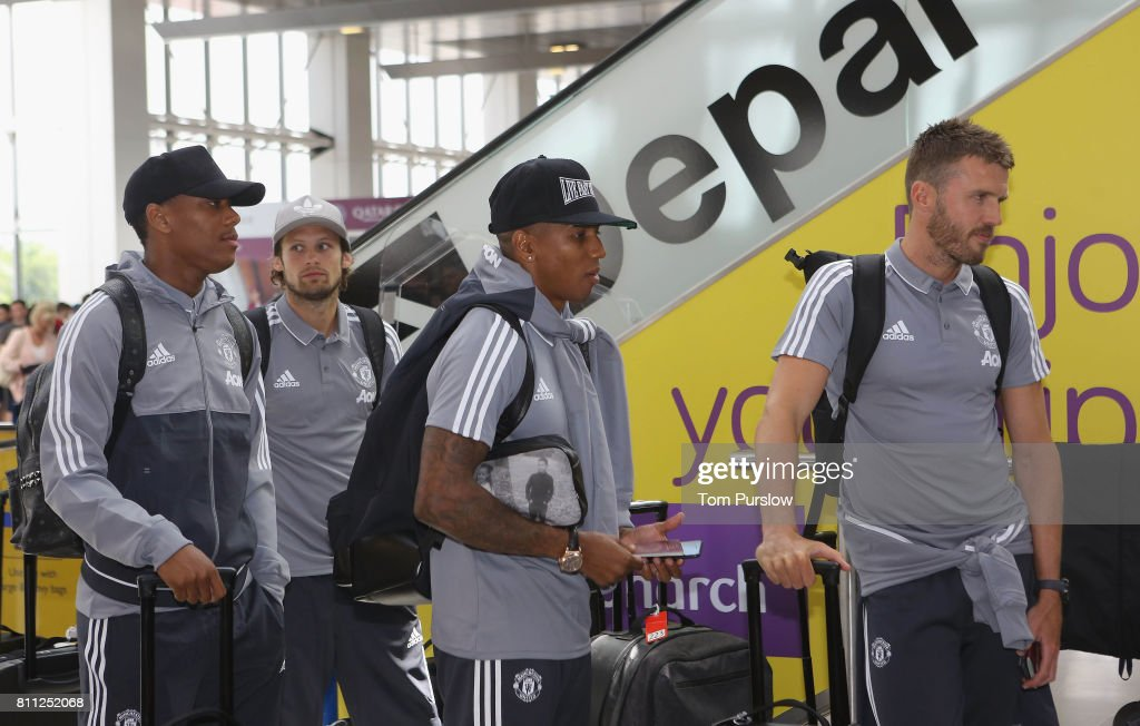 Anthony Martial, Daley Blind, Ashley Young and Michael Carrick of Manchester United check in at Manchester Airport ahead of the club's pre-season tour of the USA at Manchester Airport on July 9, 2017 in Manchester, England.