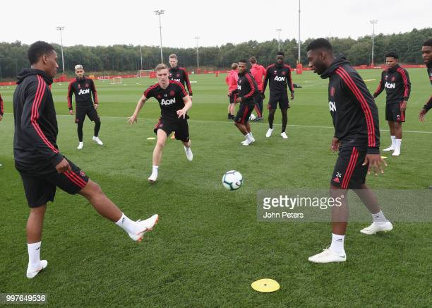 Anthony Martial Ethan Hamilton and Timothy FosuMensah of Manchester United in action during a first team training session at Aon Training Complex on...