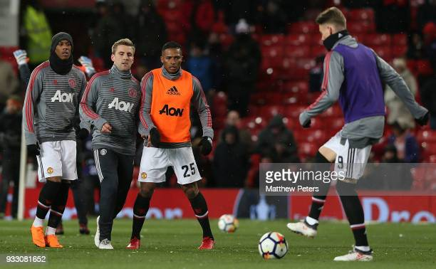 Anthony Martial Luke Shaw and Antonio Valencia of Manchester United warm up ahead of the Emirates FA Cup Quarter Final match between Manchester...