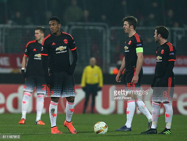Anthony Martial Michael Carrick and Juan Mata of Manchester United react to Paul Onuachu of FC Midtjylland scoring their second goal during the UEFA...