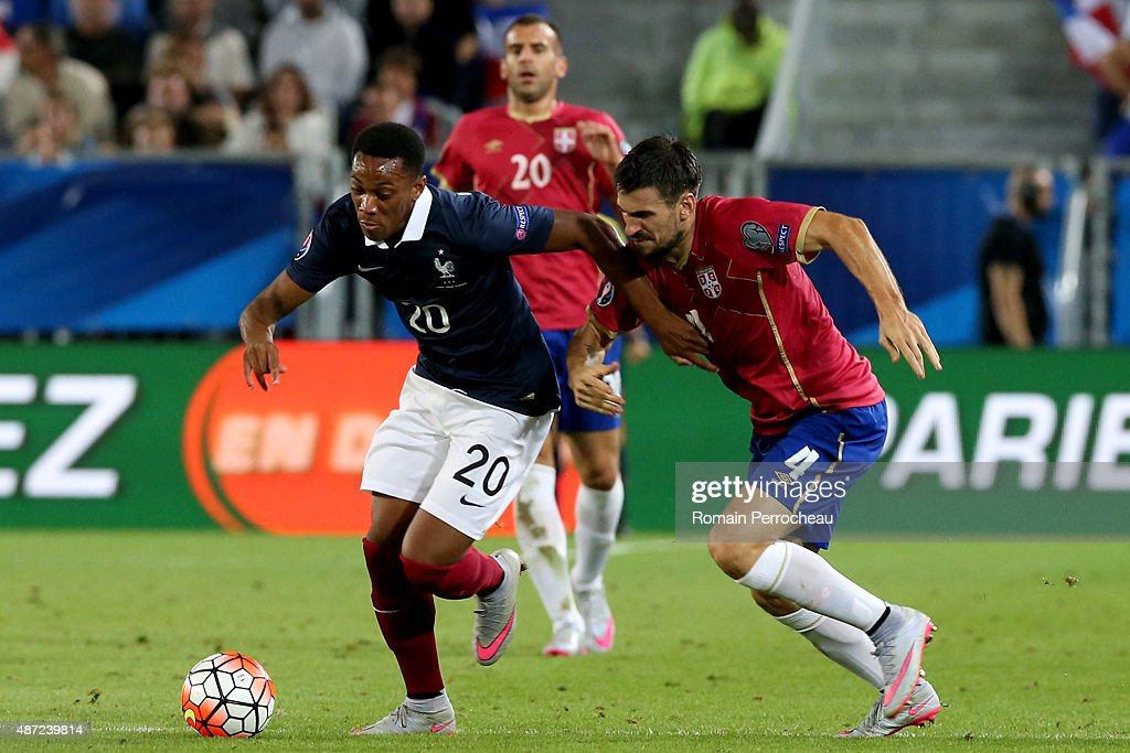 Anthony Martial of France and Nenad Tomovic of Serbia during the International Friendly game between France and Serbia on September 7, 2015 in Bordeaux, France.