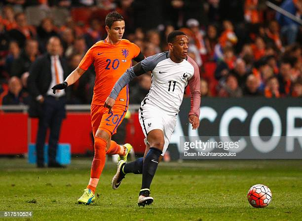 Anthony Martial of France goes past Ibrahim Afellay of the Netherlands during the International Friendly match between Netherlands and France at...
