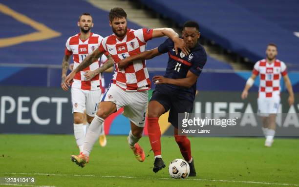 Anthony Martial of France in action with Duje CaletaCar of Croatia during the UEFA Nations League group stage match between France and Croatia at...
