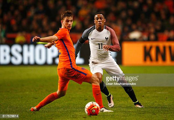 Anthony Martial of France is closed down by Joel Veltman of the Netherlands during the International Friendly match between Netherlands and France at...