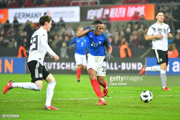 Anthony Martial of France shoots straight at the goalkeeper during the international friendly match between Germany and France at RheinEnergieStadion...